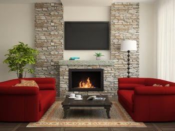 Modern Interior With Red Sofas And Fireplace